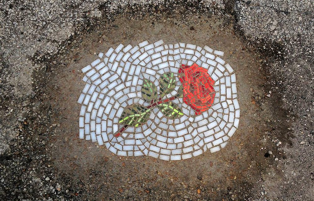 Guerrilla pothole art